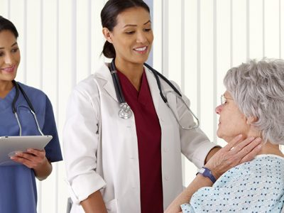 Doctor and nurse talking to patient